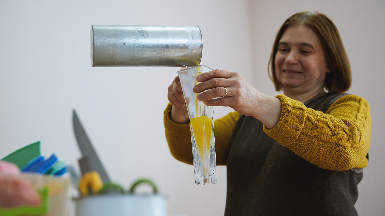 Angela Cârchilan demonstrates candle production process