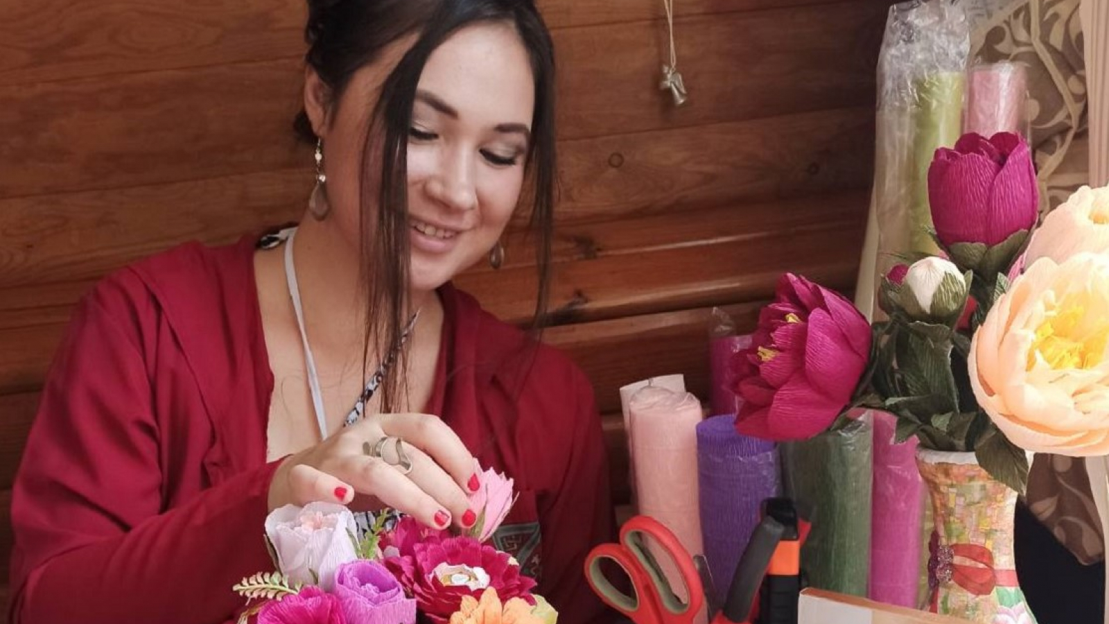 Valeriya Golovach making a gift bouquet with sweets
