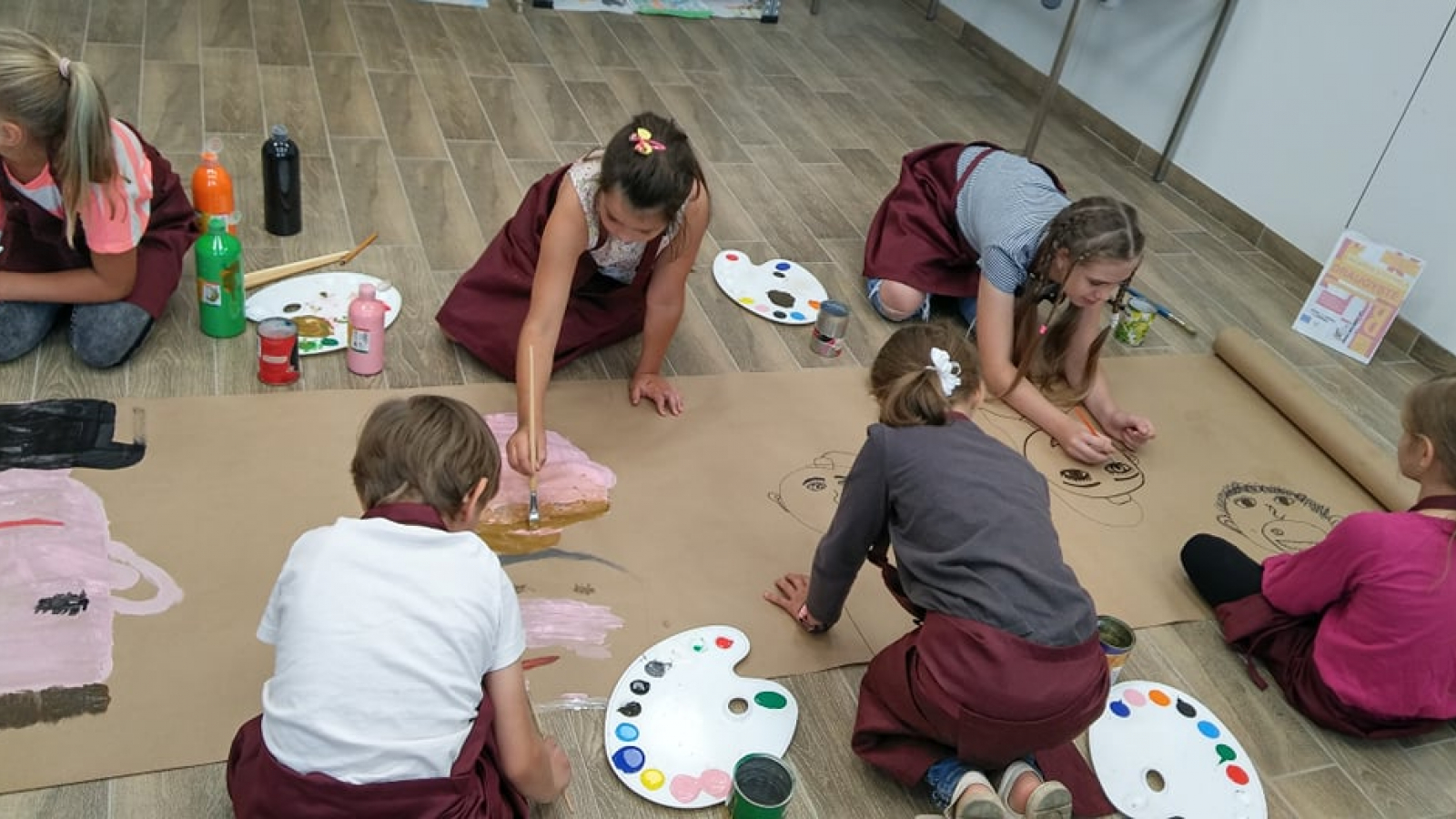Children painting during the art therapy session